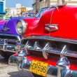 Colorful row of vintage american cars — 图库照片