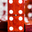 Domino tile with out of focus pieces in the background — Stock Photo #27128615