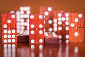 Dominoes with out of focus pieces in the back — Stock Photo