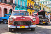 Old Chevrolet near colorful buildings in Havana — Photo