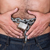Man with a chain and padlock around his stomach — Stock Photo