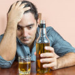 Drunk and depressed hispanic  man suffering a headache — Stock Photo