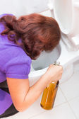 Drink woman vomiting on a toilet bowl — Stock Photo