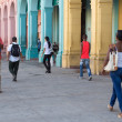 People in a colorful street in Havana, Cuba — Stock Photo