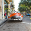 Old american car in a famous street in Havana — Stock Photo