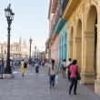 Stock Photo: People and traffic in colorful street in Havana