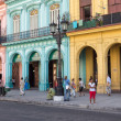 Stock Photo: People in a colorful street in Havana, Cuba