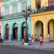 People in a colorful street in Havana, Cuba — Stock Photo