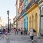 People in a colorful street in Havana, Cuba — Stock Photo #31323095