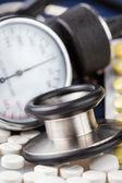 Pills, stethoscope and sphygmomanometer — Stock Photo