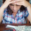 Hispanic woman counting money at home to pay the bills — Stock Photo