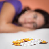 Depressed or suicidal person looking at drugs — Stock Photo