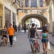 People and old shabby buildings in Havana — Stock Photo