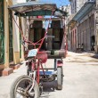 Stock Photo: Street in Havanwith old three wheeled bicycle