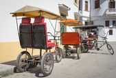 Three wheeled bicycles in Old Havana — Stock Photo