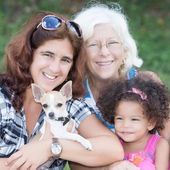 Happy hispanic family with a small dog — Stock Photo