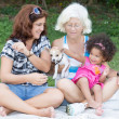 Latin Grandma, mother and daughter camping on a park — Stok fotoğraf