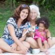 Latin Grandma, mother and daughter camping on a park — Stock Photo