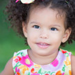 Cute hispanic girl with an afro hairstyle smiling — Stock Photo