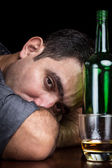 Drunk and depressed man drinking alone — Stock Photo