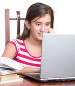 Teenager working on her laptop isolated on white — Stock Photo