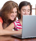 Teenager and her mother browsing the web — Stock Photo