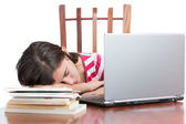 Tired student sleeping on her desk — Stock Photo