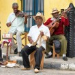 Afrocuban street musicians playing traditional music in Havana — Stock Photo #38995947