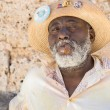 Afrocuban man smoking a cigar in Old Havana — Stock Photo #39336571