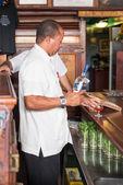 Bartender working at La Bodeguita del Medio in Havana — Stock Photo