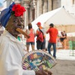 Old black lady smoking a cuban cigar in Havana — Stock Photo #39807071