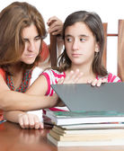 Mother checks her daughter internet activity — Stock Photo