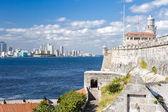 The lighthouse of El Morro with the Havana skyline — Stock Photo