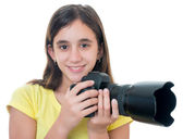 Girl using a professional camera isolated on white — Foto Stock