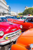 Colorful group of classic american cars in Havana — Stock Photo