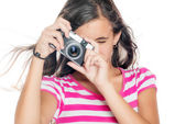 Young girl using a compact camera — Stock Photo