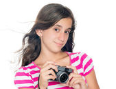 Young girl holding a compact camera with her hair floating in th — Stock Photo
