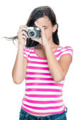 Cute young girl taking a photo — Stock Photo