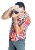 Hispanic man using a vintage looking compact camera — Foto de Stock