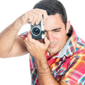 Man using a vintage looking compact camera isolated on white — Stock Photo