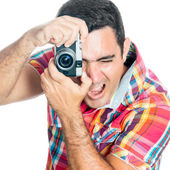 Man using a vintage looking compact camera — Stockfoto