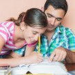 Father helping his daughter to study — Stock Photo
