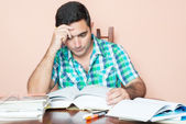 Adult hispanic man studying — Stock Photo