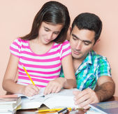 Father studying with his daughter — Stock Photo