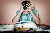 Stressed overworked man studying — Stock Photo