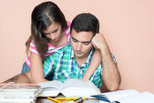 Young man studying with his daughter hugging him — Stock Photo
