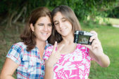 Teen and her young mother taking a self picture — Stock Photo