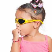 Multiracial small girl  wearing yellow sunglasse — Stock Photo