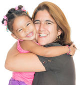Mother hugging her small multiracial daughter — Stock Photo