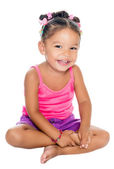 Multiracial small girl laughing sitting on the floor — Stock Photo